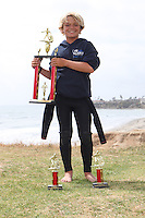 "San Diego CA, USA.  Monday, May 19th 2014:  Members of the Pacific Beach Middle School Surf Team (aka ""PB Locals"") pose near Law Street in Pacific Beach for a group photo.  The team finished the season in first place in the San Diego Scholastic Surf Series Middle School Division 2 Contest beating out six other teams from across the county in five contests that were held during the school year.  Students Matthew Ferris and Tyler Reed placed in the top ten for Boys Shortboard, Andrew Feighan finsished 6th overall in Boys Longboard, Nicolas Campagna finsihed 2nd overall in Body Board, Ciara Gray finished in 1st place overall for Girls Longboard and 3rd place overall for Girls Shortboard.  Shelby Moore finished in 1st Place overall for Girls Shortboard and 6th place overall for Girls Longboard."