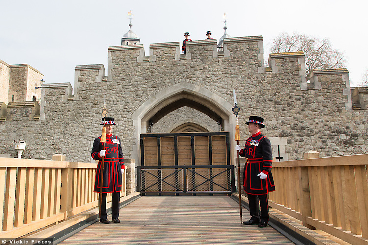 Yeomen Warder stand in front of a new drawbridge which is opened at the Tower of London in Tower Hill, London today, 2nd April 2014. This is the first working and rising drawbridge at the Tower of London since the 1970's.