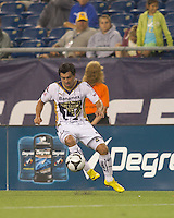 Pumas UNAM forward Juan Carlos Cacho (11) traps the ball. The New England Revolution defeated Pumas UNAM in SuperLiga group play, 1-0, at Gillette Stadium on July 14, 2010.