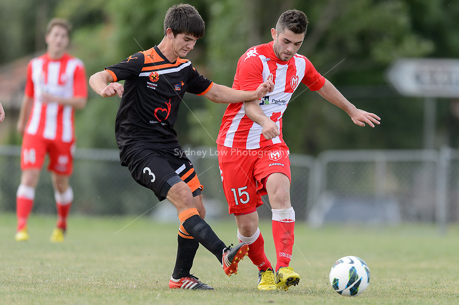 MELBOURNE - 3 NOV: Cameron CRESTANI of the Roar and Evangelos BATSIS of the Heart compete for the ball in the round three National Youth League match between Melbourne Heart and Brisbane Roar at John Cain Reserve on 3 November 2012. (Photo Sydney Low/syd-low.com/Melbourne Heart)