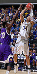 SIOUX FALLS, SD - MARCH 7:  Cody Larson #34 of South Dakota State takes a jump shot against defender  Jalen Chapman #33 of Western Illinois  in the second half of the first round of the men's Summit League Championship Tournament game Saturday evening at the Denny Sanford Premier Center in Sioux Falls, SD.(Photo by Dave Eggen/Inertia)