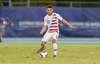 GEORGETOWN, GRAND CAYMAN, CAYMAN ISLANDS - NOVEMBER 19: Cristian Roldan #10 of the United States passes off the ball during a game between Cuba and USMNT at Truman Bodden Sports Complex on November 19, 2019 in Georgetown, Grand Cayman.