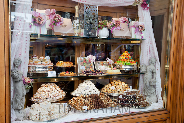 Cakes, sweets andpastries in shop window of luxury patticeria, caffe sweet shop Gilli, established in 1733 in Florence, Tuscany, Italy