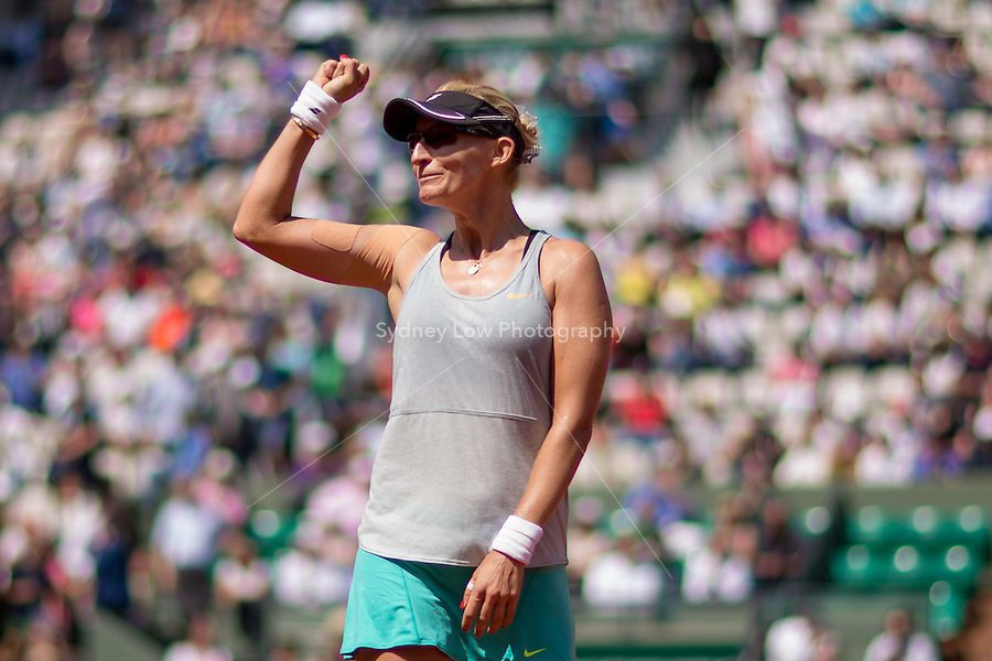 May 27, 2015: Mirjana Lucic-Baroni of Croatia celebrates her win in a 2nd round match against Simona Halep of Romania on day four of the 2015 French Open tennis tournament at Roland Garros in Paris, France. Sydney Low/AsteriskImages