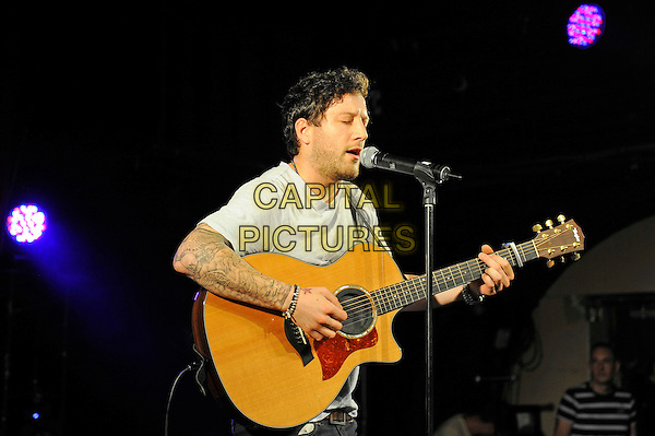 Matt Cardle <br /> performing at G-A-Y, Heaven Nightclub, London, England. <br /> 17th August 2013<br /> on stage in concert live gig performance performing music half length grey gray t-shirt singing profile tattoos guitar<br /> CAP/MAR<br /> &copy; Martin Harris/Capital Pictures