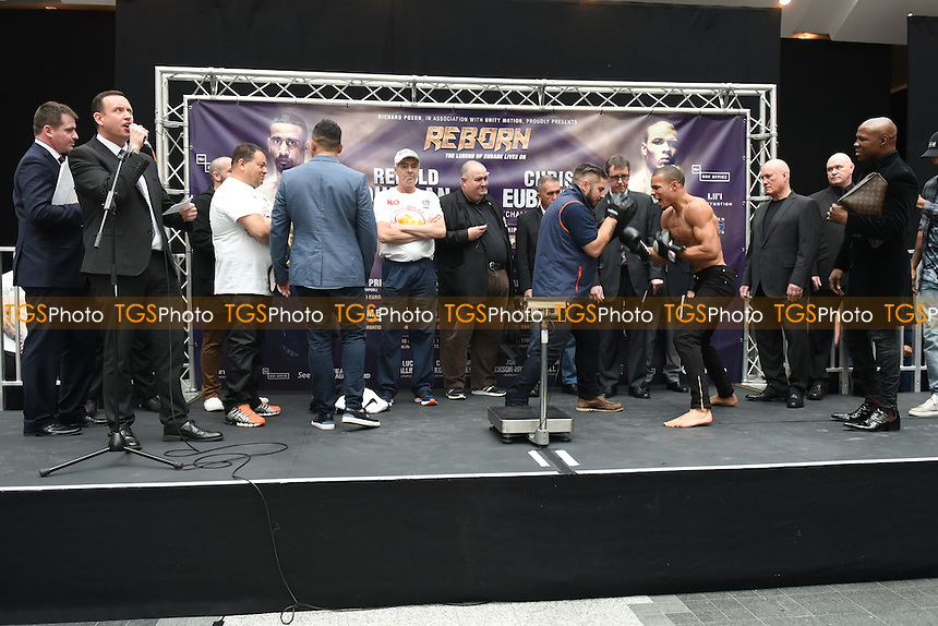 Boxer Chris Eubank Jr with some pad work during a Poxon Sports Weigh-In at Westfield Shopping Centre on 3rd February 2017