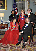The 2003 Kennedy Center Honors recipients pose for a group photo after a dinner at the United States State State Department hosted by United States Secretary of State Colin Powell in Washington, DC on December 6, 2003.  Honorees, clockwise from foreground left are singer Loretta Lynn, singer James Brown, comedian Carol Burnett, director Mike Nichols, and violinist Itzhak Perlman..