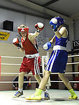 Andrew Stokes (in blue) from Hanlon Park boxing Club Dundalk and Jake Tucker from Newry Boxing Club in action in the Louth Meath Boxing Championships held in Holy Family Boxing Club Ballsgrove.  Photo:Colin Bell/pressphotos.ie
