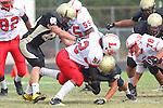 Palos Verdes, CA 09/30/11 - Will Cummins (Peninsula #83), unidentified Lawndale player(s) and Jin Matsumoto (Peninsula #40) in action during the Lawndale-Peninsula Varsity football game.