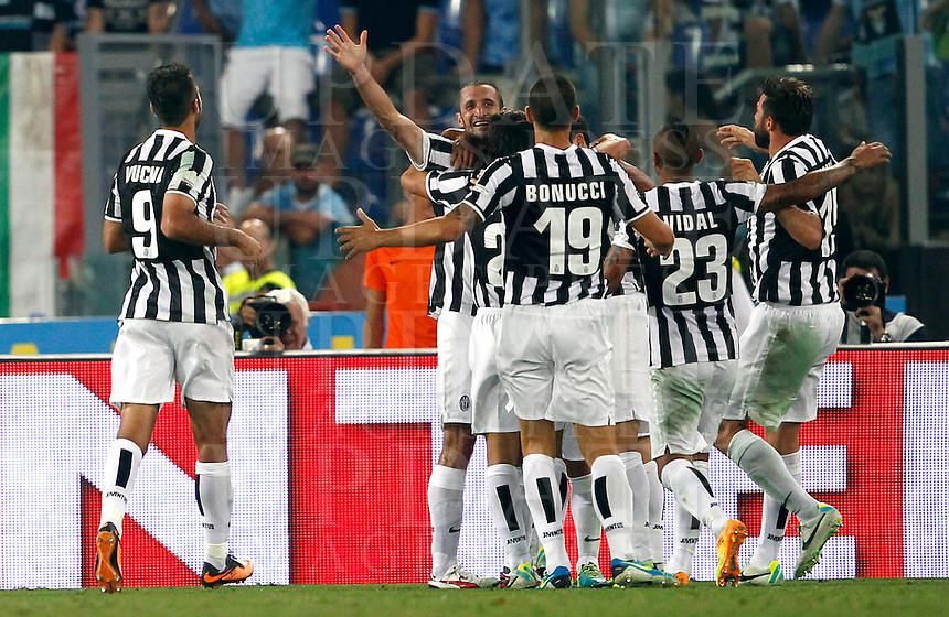 Calcio, Supercoppa di Lega: Juventus vs Lazio. Roma, stadio Olimpico, 18 agosto 2013.<br /> Juventus defender Giorgio Chiellini, second from left, celebrates with teammates during the Italian League Supercup football final match between Juventus and Lazio, at Rome's Olympic stadium,  18 August 2013.<br /> UPDATE IMAGES PRESS/Isabella Bonotto