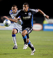 Jason Hernandez (right) gets to the ball ahead of Davy Arnaud (left). The San Jose Earthquakes defeated the Kansas City Wizards in stoppage time 1-0 at Buck Shaw Stadium in Santa Clara, California on August 22, 2009.