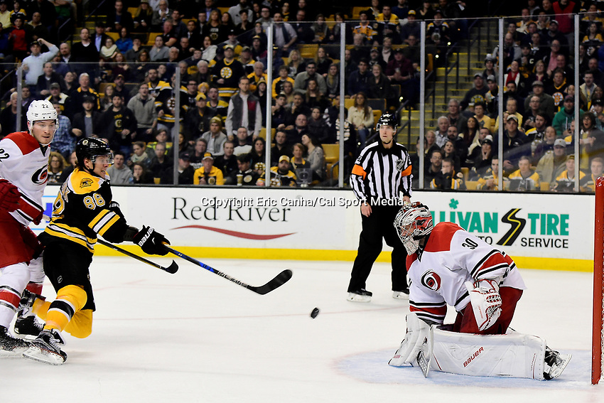 Thursday, December 1, 2016: Boston Bruins right wing David Pastrnak (88) shoot against Carolina Hurricanes goalie Cam Ward (30) during the National Hockey League game between the Carolina Hurricanes and the Boston Bruins held at TD Garden, in Boston, Mass. Boston defeats Carolina 2-1 in overtime. Eric Canha/CSM