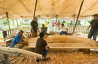 NWA Democrat-Gazette/BEN GOFF @NWABENGOFF<br /> Workers join the upper and lower parts of the main hull of the KorKor Tuesday, May 8, 2018, at the Shiloh Museum of Ozark History in Springdale. Master canoe builder Liton Beasa and his family, in partnership with the Shiloh Museum of Ozark History, began building the two-man Marshallese canoe called a KorKor April 14 and plan to display the finished canoe at the Little Craft Show Saturday in downtown Springdale.