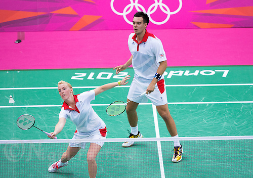 28 JUL 2012 - LONDON, GBR - Imogen Bankier (GBR) of Great Britain returns during the London 2012 Olympic Games mixed doubles group badminton match with partner Chris Adcock (GBR) against Alexandr Nikolaenko and Valeria Sorokina of Russia at Wembley Arena, London, Great Britain (PHOTO (C) 2012 NIGEL FARROW)