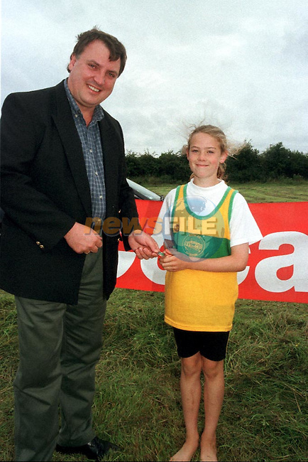 Emer McTaggart receives her medal from Tony Campion of Drogheda Contrates..Pic Fran Caffrey / Newsfile