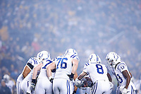 Matt Hasselbeck #8 of the Indianapolis Colts huddles with his team as smoke from fireworks fill the air in the first quarter against the Pittsburgh Steelers during the game at Heinz Field on December 6, 2015 in Pittsburgh, Pennsylvania. (Photo by Jared Wickerham/DKPittsburghSports)