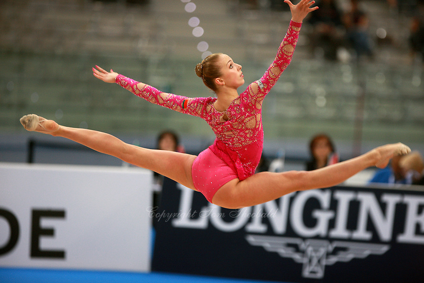 Inna Zhukova of Belarus split leaps to recatch hoop during All Around final at  2008 European Championships at Torino, Italy on June 6, 2008.  Photo by Tom Theobald.