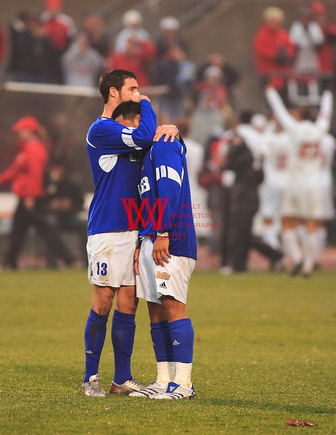 Chris Pontius (#13 UCSB) consoles Alfonso Motagalvan (#11 UCSB) after their loss to the Ohio State University December 2nd, 2007, while The Ohio State University Men's Soccer team celebrate in the background.