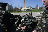 Ukrainian soldiers leaving the Belbek military base - one of the  last bases in the Crimea which remains loyal to the Ukrainian government after passage to Russian Federation