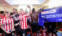 Lincoln City's Harry Anderson, left, Lincoln City's assistant manager Nicky Cowley and Lincoln City's Michael O'Connor lead the celebrations in the changing rooms after the Imps were confirmed as league champions<br /> <br /> Photographer Chris Vaughan/CameraSport<br /> <br /> The EFL Sky Bet League Two - Lincoln City v Tranmere Rovers - Monday 22nd April 2019 - Sincil Bank - Lincoln<br /> <br /> World Copyright © 2019 CameraSport. All rights reserved. 43 Linden Ave. Countesthorpe. Leicester. England. LE8 5PG - Tel: +44 (0) 116 277 4147 - admin@camerasport.com - www.camerasport.com