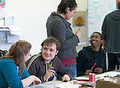 An autistic student talking with his Student Support Worker (foreground) and a hearing impaired student talking with the tutor, Art & Design, Kingston College.