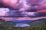 Donner Lake at sunset. The last glimpse of the sun turns the clouds and mountains pink.