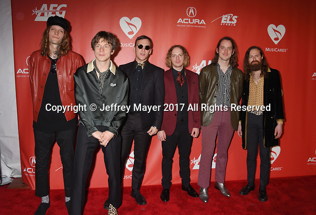 LOS ANGELES, CA - FEBRUARY 10: (L-R) Musicians Daniel Tichenor, Matt Shultz, Jared Champion, Brad Shultz, Matthan Minster and Nick Bockrath of Cage the Elephant attend MusiCares Person of the Year honoring Tom Petty at the Los Angeles Convention Center on February 10, 2017 in Los Angeles, California.