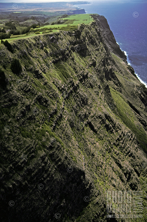 The steep and forbidding green cliffs of the Kalaupapa coast