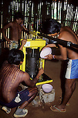 A-Ukre village, Brazil. Kayapo Indians from using a press to extract Brazil nut oil; Xingu.