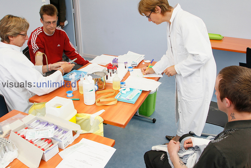 Nurses conducting blood tests on patients, Lille Institut Pasteur, France