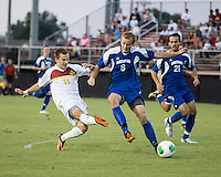 Winthrop University Eagles vs the Brevard College Tornados at Eagle's Field in Rock Hill, SC.  The Eagles beat the Tornados 6-0.  Patrick Barnes (11) takes a shot for the third goal of the game for Winthrop in the 9th minute.  Patrick Barnes (11) and Garrett Stone (8) fight for the ball.
