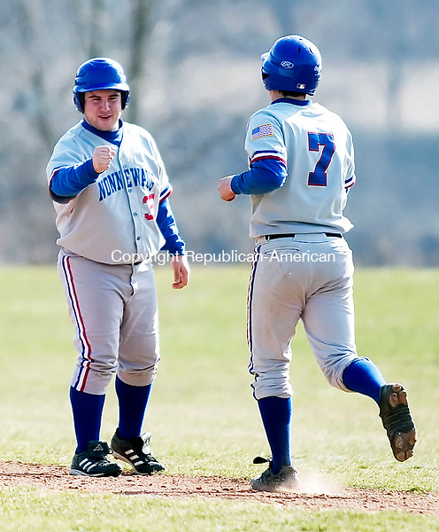 WOODBURY, CT- 11 APRIL 07- 041107JT10- <br /> Nonnewaug first base coach ????? ?????? (ask Jaffee if he's available) congratulates Mike Kuzma as he walks to first base at Wednesday's game at Nonnewaug.<br /> Josalee Thrift Republican-American