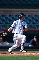 Scottsdale Scorpions first baseman Billy McKinney (53), of the New York Yankees organization, follows through on his swing during an Arizona Fall League game against the Surprise Saguaros on October 27, 2017 at Scottsdale Stadium in Scottsdale, Arizona. The Scorpions defeated the Saguaros 6-5. (Zachary Lucy/Four Seam Images)