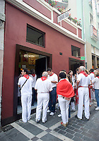 People wait to buy `churros' at the Churreria La Mañueta on July 9, 2013, in Iruña-Pamplona, Basque Country. The churreria Mañueta exists since December 13, 1872. Five generations of the family Elizabeth-Fernández has worked on the Mañueta churrería since 1872. During San Fermin Festival is an old tradition to eat 'churros' in the morning before and after the running of the bulls. Mañueta opens its doors for the last two Saturdays of June, the festival of San Fermin and all Sundays in October. (Ander Gillenea / Bostok Photo)
