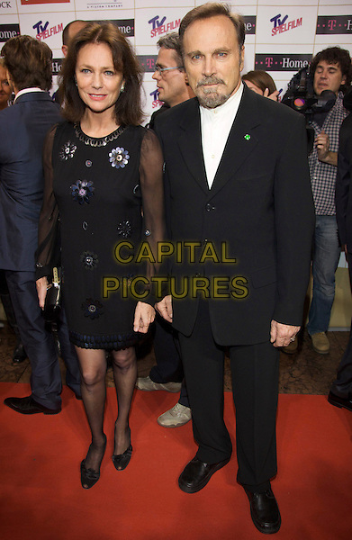 JACQUELINE BISSET, FRANCO NERO .DIVA Entertainment Awards 2009, Hotel Bayerischer Hof, Munich, Germany, .27th January 2009..full length black dress suit sheer sleeves flower dress .CAP/PPG.©Jens Hartmann/People PIcture/Capital Pictures