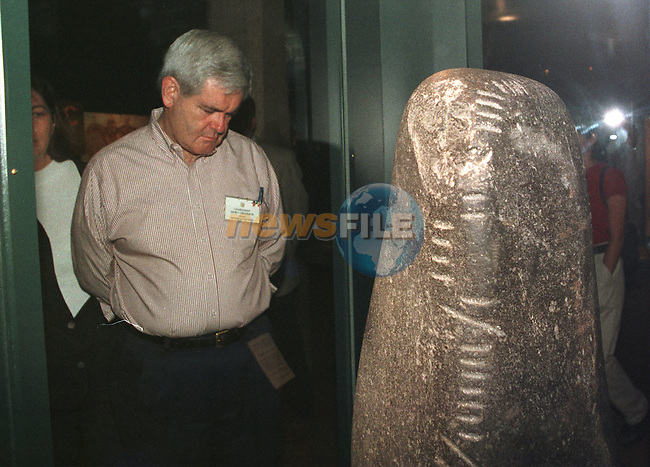 Congressman Newt Gingrich speaker of the House touring Trinity College in Dublin Ireland, Looking at one of the Ogham stones during his week long stay in the country.Picture Fran Caffrey/ Newsfile/AFP