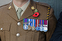Pictured: A poppy and medals worn by a member of the Armed Forces. Sunday 11 November 2018<br /> Re: Commemoration for the 100 years since the end of the First World War on Remembrance Day at the Swansea Cenotaph in south Wales, UK.