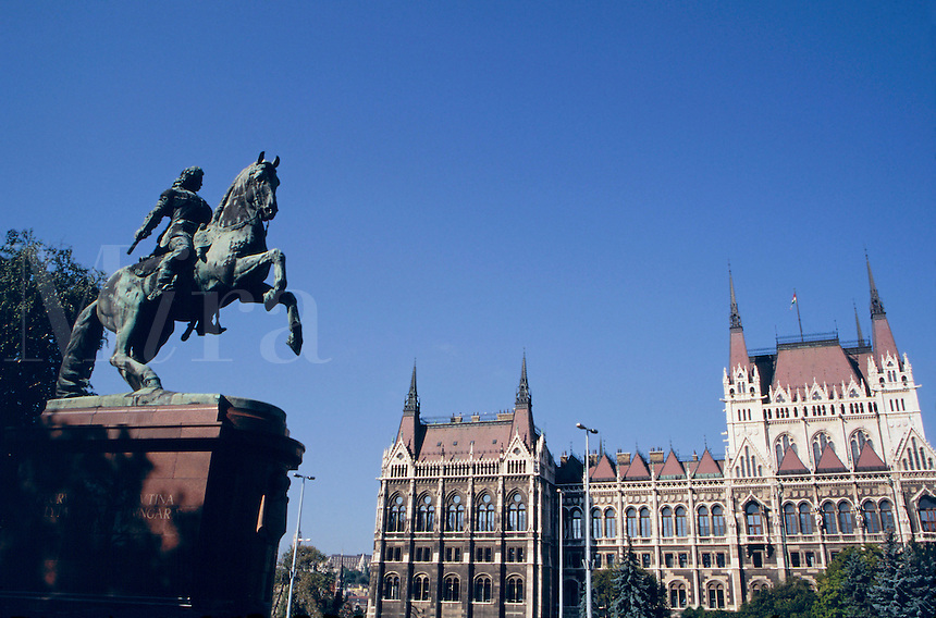 The Hungarian House of Parliament built 1896 - 1904 and patterned after Westminster in England. A monument to Rakoczi is at left. Budapest, Hungary.