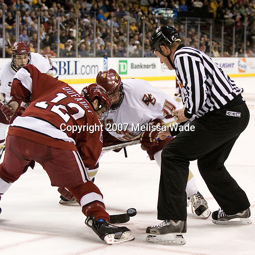 Paul Dufault (Harvard University - Shrewsbury, MA) and Matt Greene (Boston College - Plymouth, MA) face off with Matt Lombardi (Boston College - Milton, MA) looking on. The Boston College Eagles defeated the Harvard University Crimson 3-1 in the first round of the 2007 Beanpot Tournament on Monday, February 5, 2007, at the TD Banknorth Garden in Boston, Massachusetts.  The first Beanpot Tournament was played in December 1952 with the scheduling moved to the first two Mondays of February in its sixth year.  The tournament is played between Boston College, Boston University, Harvard University and Northeastern University with the first round matchups alternating each year.