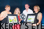 Artist Phil O'Grady presented each dancer a work art at the Irish cancer Society Strictly Come Dancing here she is presenting the winners Grainne O'Sullivan and Michael Bernard O'Donoghue with Kathrina Breen ICS on the night in the INEC