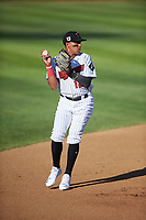 Great Falls Voyagers shortstop Lency Delgado (12) prepares to throw to first base during a Pioneer League game against the Missoula Osprey at Centene Stadium at Legion Park on August 19, 2019 in Great Falls, Montana. Missoula defeated Great Falls 4-1 in the first game of a doubleheader. Games were moved from Missoula after Ogren Park at Allegiance Field, the Osprey's home field, was ruled unplayable. (Zachary Lucy/Four Seam Images)