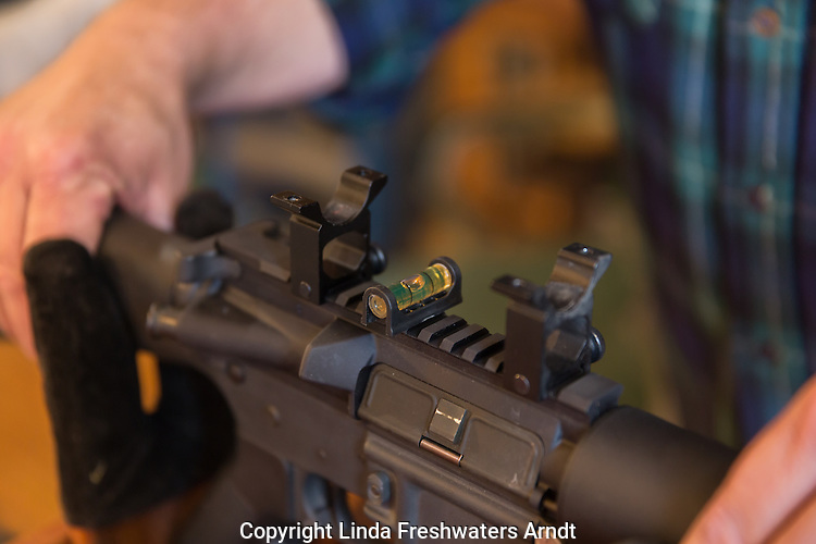 Leveling Colt AR 15 rifle prior to mounting scope