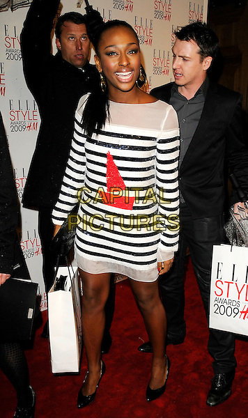 ALEXANDRA BURKE .Attending the Elle Style Awards 2009 at Big Sky London, England,.February 9th 2009..full length red boat sequined blue and white striped dress paper bag  D&G D & G black shoes.CAP/CAN.©Can Nguyen/Capital Pictures