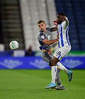 Lincoln City's Harry Toffolo battles with Huddersfield Town's Isaac Mbenza<br /> <br /> Photographer Andrew Vaughan/CameraSport<br /> <br /> The Carabao Cup First Round - Huddersfield Town v Lincoln City - Tuesday 13th August 2019 - John Smith's Stadium - Huddersfield<br />  <br /> World Copyright © 2019 CameraSport. All rights reserved. 43 Linden Ave. Countesthorpe. Leicester. England. LE8 5PG - Tel: +44 (0) 116 277 4147 - admin@camerasport.com - www.camerasport.com