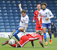 Bury's Chris Maguire is tackled by Milton Keynes Dons' Aaron Tshibola<br /> <br /> Photographer Juel Miah/CameraSport<br /> <br /> The EFL Sky Bet League One - Bury v Milton Keynes Dons - Saturday 30th September 2017 - Gigg Lane - Bury<br /> <br /> World Copyright &copy; 2017 CameraSport. All rights reserved. 43 Linden Ave. Countesthorpe. Leicester. England. LE8 5PG - Tel: +44 (0) 116 277 4147 - admin@camerasport.com - www.camerasport.com