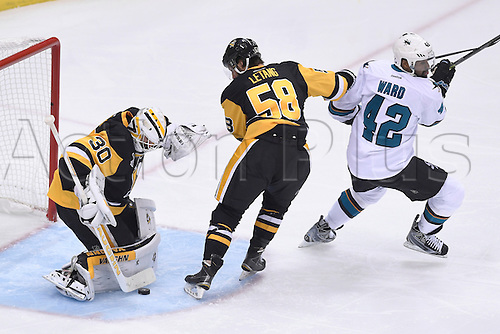 01.06.2016. Pittsburgh, Penn, USA.  Pittsburgh Penguins goalie Matt Murray (30) makes a save on San Jose Sharks right wing Joel Ward (42) in front as Pittsburgh Penguins defenseman Kris Letang (58) defends during the first period in the 2016 NHL Stanley Cup Final - Game Two between the San Jose Sharks and the Pittsburgh Penguins at the Consol Energy Center in Pittsburgh, Pennsylvania.