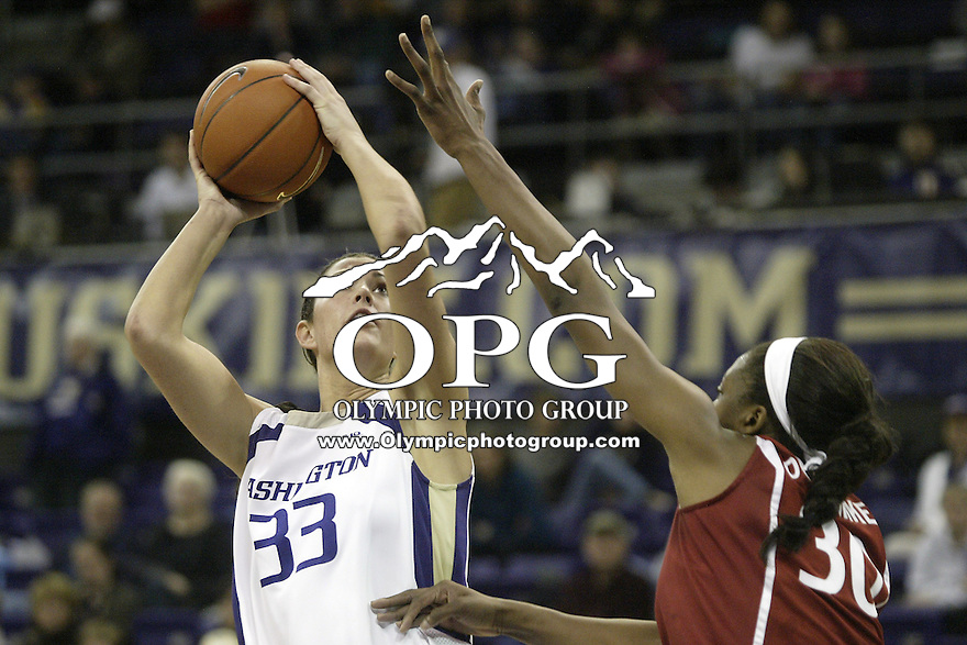 12 February 2010:  Washington Huskies forward #33 Mackenzie Argens goes up for a basket against Stanford. Stanford won 58-36 over Washington at the Bank of America Arena in Seattle, WA.