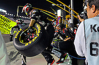 Jeff Gordon's (#24) crew launches from the wall to perform a pit stop.
