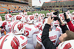 Wisconsin Badgers teammates huddle prior to an NCAA College Big Ten Conference football game against the Illinois Fighting Illini Saturday, October 28, 2017, in Champaign, Illinois. The Badgers won 24-10. (Photo by David Stluka)