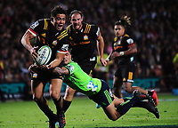 Aaron Smith tackles Anton Lienert during the Super Rugby match between the Chiefs and Highlanders at FMG Stadium in Hamilton, New Zealand on Friday, 30 March 2018. Photo: Dave Lintott / lintottphoto.co.nz